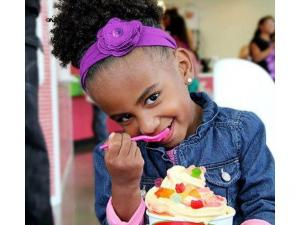 a little girl eating froyo in a cherryberry store