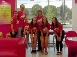 cherryberry branding with a team of employees